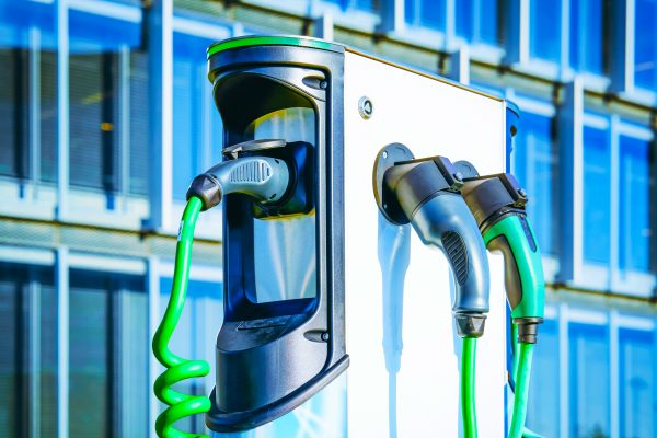Electric Car Charging station. Battery hybrid vehicle eco charger. Future energy power. Green technology. Transport plug. Fuel recharge. Clean ecology concept. Modern supply